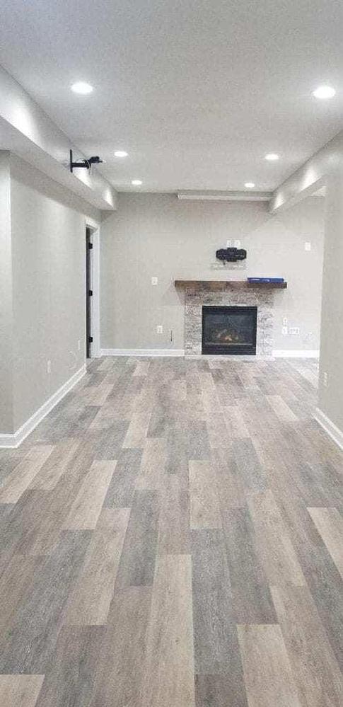 Fireplace Basement with LVT Flooring